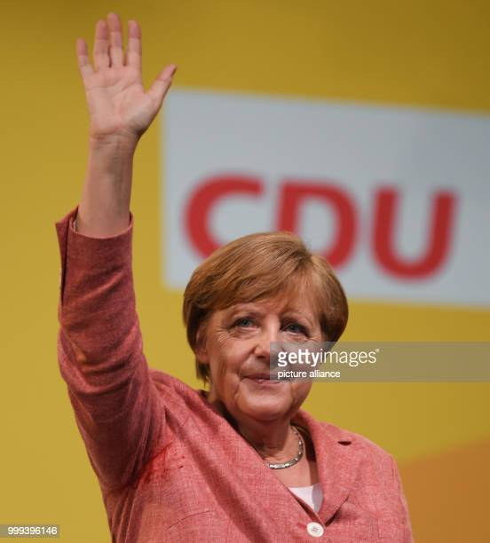 German Chancellor Angela Merkel waves her hand during an event of the CDUelection camapign in Fulda Germany 25 August 2017 Photo Arne Dedert/dpa