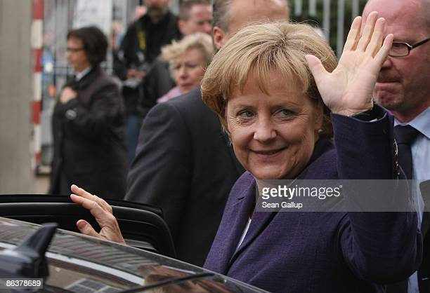German Chancellor Angela Merkel waves to onlookers after touring the former prison of the East German communistera secret police known as the Stasi...