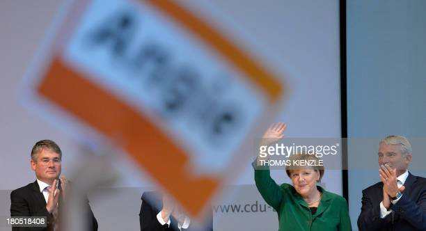 German Chancellor Angela Merkel waves to supporters after giving a speech at a regional convention of her Christian Democratic Union party in...