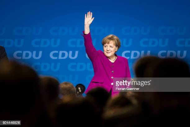 German Chancellor Angela Merkel, waves to the delegates at the 30th German Christian Democrats party congress on February 26, 2018 in Berlin,...