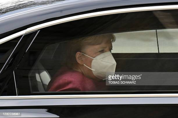 German Chancellor Angela Merkel, wearing a face mask, arrives by car for talks of the conservative Christian Democratic Union party and its Bavarian...