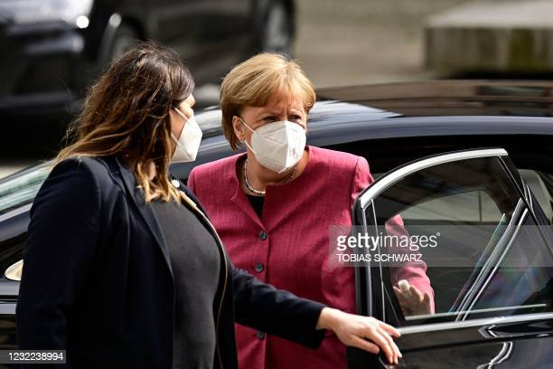 German Chancellor Angela Merkel, wearing a face mask, arrives for talks of the conservative Christian Democratic Union party and its Bavarian...