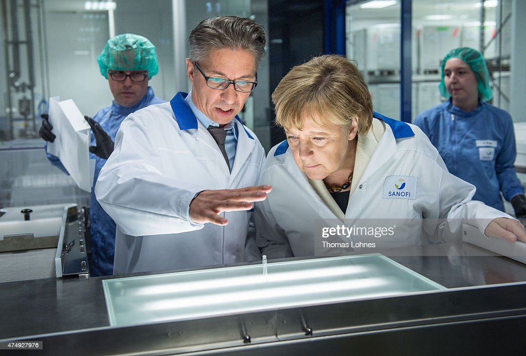 Chancellor Merkel Visits Sanofi Plant : News Photo
