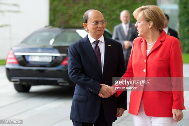 German Chancellor Angela Merkel welcomes Burmese President Thein Sein with military honours at the Federal Chancellery in Berlin, Germany, 03...