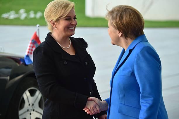 German Chancellor Angela Merkel welcomes Croatian President Kolinda Grabar-Kitarovic in front of the Chancellery in Berlin on March 17, 2015. AFP...