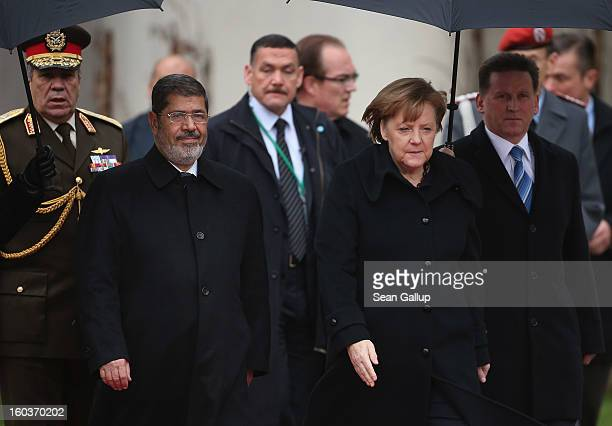 German Chancellor Angela Merkel welcomes Egyptian President Mohamed Mursi upon his arrival at the Chancellery on January 30, 2013 in Berlin, Germany....