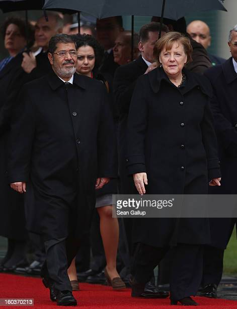 German Chancellor Angela Merkel welcomes Egyptian President Mohamed Mursi upon his arrival at the Chancellery on January 30 2013 in Berlin Germany...