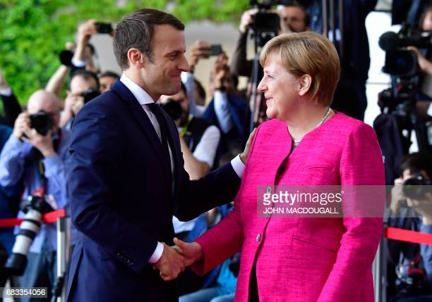 TOPSHOT German Chancellor Angela Merkel welcomes French President Emmanuel Macron for talks on strengthening the EU a day after the new French...