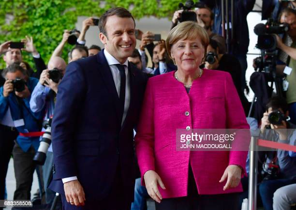 German Chancellor Angela Merkel welcomes French President Emmanuel Macron for talks on strengthening the EU, a day after the new French president...