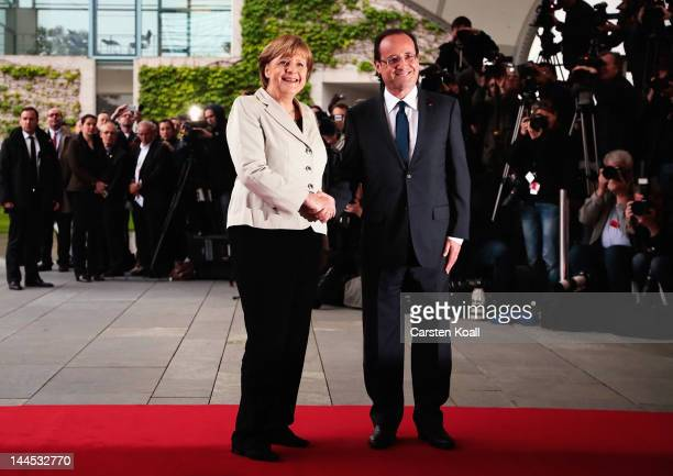 German Chancellor Angela Merkel welcomes French President Francois Hollande at the Chancellery hours after Hollande's inauguration in Paris on May 15...