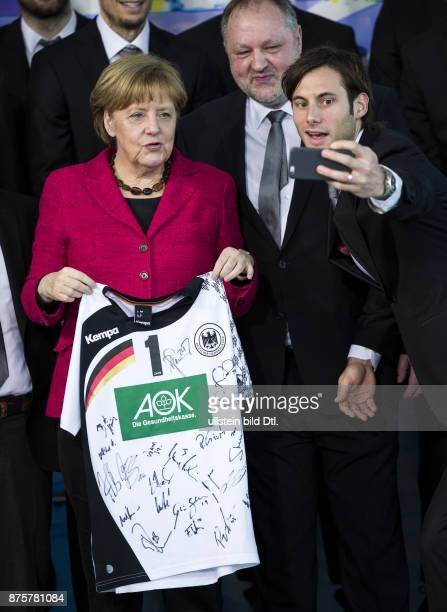 German Chancellor Angela Merkel welcomes German handball European champions on March 9 2016 at the Federal Chancellery in Berlin CaptainUwe...