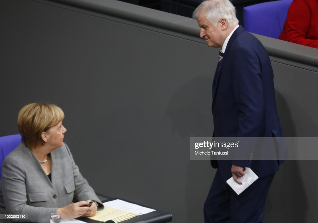 German Chancellor Angela Merkel (CDU) welcomes Interior Minister Horst Seehofer (CSU) during a session of the German Parliament or Bundestag on September 13, 2018 in Berlin, Germany. Relations within the governing German coalition have once again become strained, this time due to comments made by German Interior Minister and Bavarian Christian Social Union leader Horst Seehofer following the recent murder of a German by refugees and the ensuing marches by right-wing supporters in the city of Chemnitz.