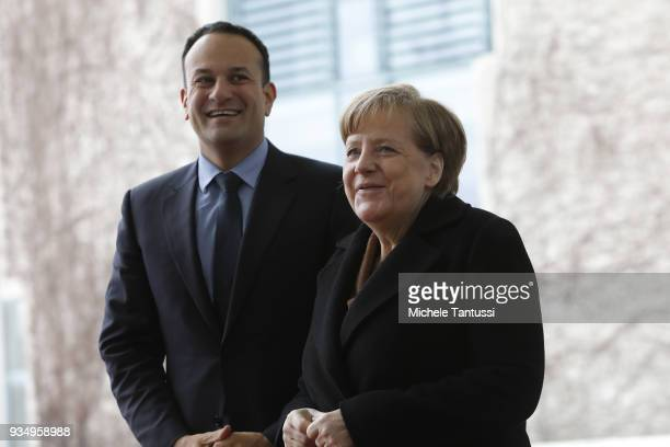 German Chancellor Angela Merkel welcomes Irish Prime Minister Leo Varadkar at the courtyard of the German Chancellory on March 20 2018 in Berlin...