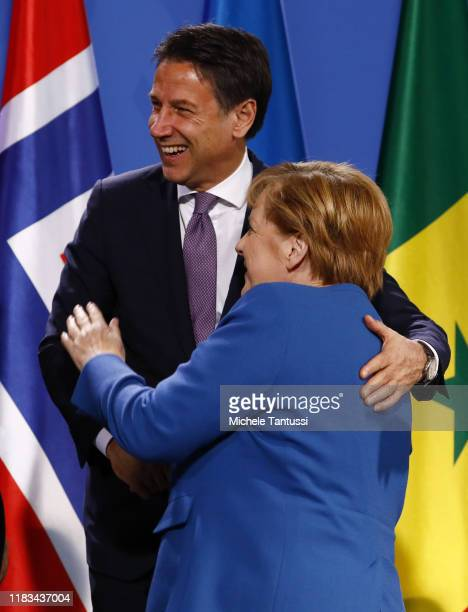 German Chancellor Angela Merkel welcomes Italian Premier Giuseppe Conte as leaders of African states and the EU pose during a Family Photo at the...