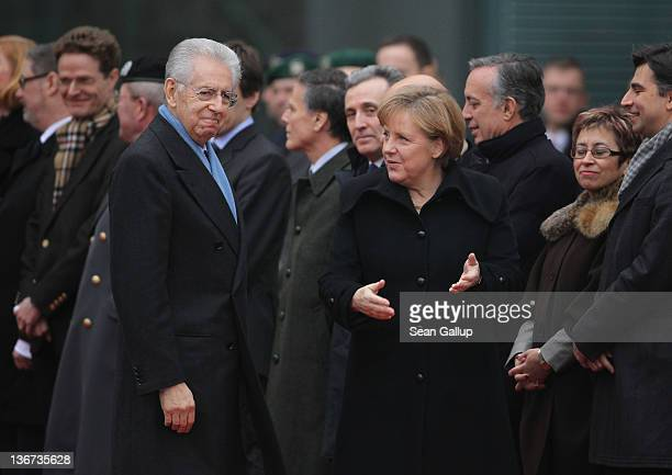 German Chancellor Angela Merkel welcomes Italian Prime Minister Mario Monti upon Monti's arrival at the Chancellery on January 11, 2011 in Berlin,...