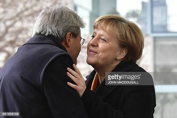 German Chancellor Angela Merkel welcomes Italian Prime Minister Paolo Gentiloni at the Chancellery in Berlin on January 18 2017 / AFP / John...