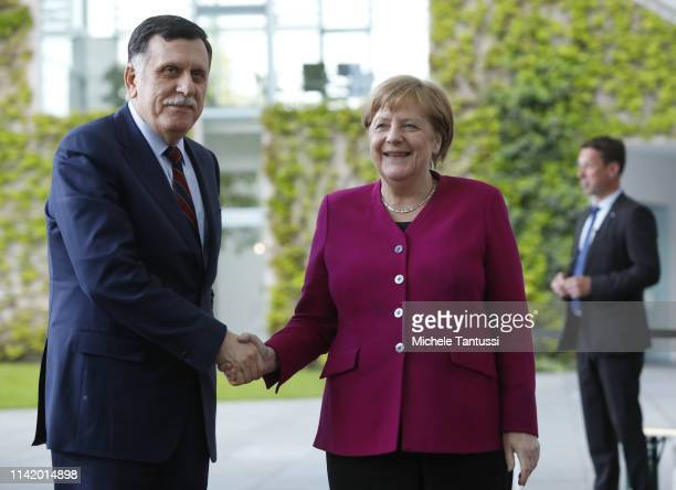 German Chancellor Angela Merkel , welcomes Libyan Prime Minister Fayez Al Sarraj in the courtyard of the Chancellery on May 7, 2019 in Berlin,...