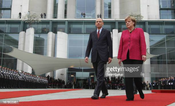 German Chancellor Angela Merkel welcomes new Italian Prime Minister Enrico Letta at the Chancellery on April 30 2013 in Berlin Germany Letta is in...