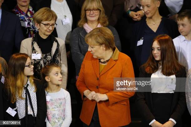 German Chancellor Angela Merkel welcomes on December 14 2016 members of the Bundeswehr's armed forces as well as with police officers who are abroad...