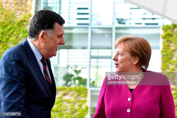 German Chancellor Angela Merkel welcomes Prime Minister of the Government of National Accord of Libya Fayez alSarraj for a meeting on May 7 2019 in...