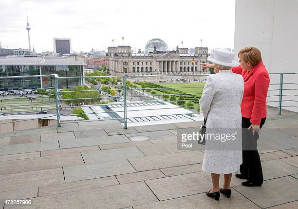 German Chancellor Angela Merkel welcomes Queen Elizabeth II upon her arrival at the Federal Chancellery on the second of the royal couple's fourday...