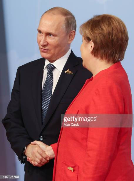 German Chancellor Angela Merkel welcomes Russian Vladimir Putin at the start of the the G20 summit on July 7 2017 in Hamburg Germany Leaders of the...