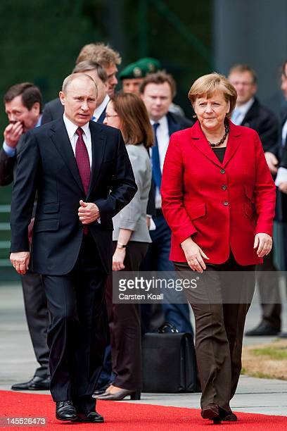German Chancellor Angela Merkel welcomes Russia's President Vladimir Putin with military honours at her offices on June 1 2012 in Berlin Germany...