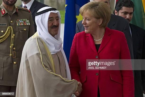 German Chancellor Angela Merkel welcomes Sheikh Sabah Al-Ahmad Al-Jaber Al-Sabah, Emir of Kuwait, on April 26, 2010 at the Chancellery in Berlin. AFP...