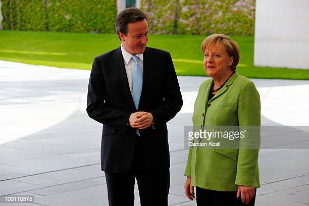 German Chancellor Angela Merkel welcomes the British Prime Minister David Cameron at the Chancellery on May 21 2010 in Berlin Germany Cameron is...