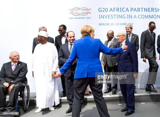 German Chancellor Angela Merkel welcomes the participants to the G20 Africa Conference at the Euref Campus Berlin on 12 June 2017 The family photo...
