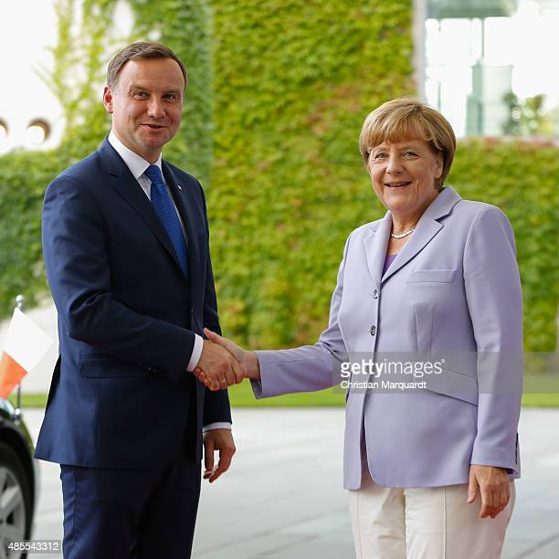 German Chancellor Angela Merkel welcomes the Polish President MInister Andrzej Duda at the Chancellery on August 28 2015 in Berlin Germany Topics of...