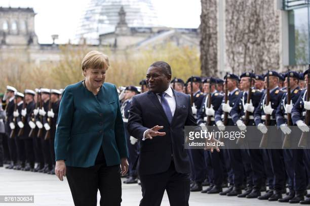 German Chancellor Angela Merkel welcomes the President Filipe Nyusi from Mozambique on 19 April 2016 with military honors in Berlin.