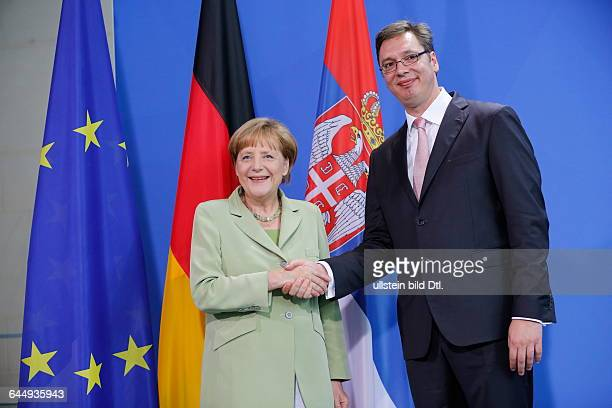 German Chancellor Angela Merkel welcomes the Serbian Prime Minister Aleksander Vucic with military honors on June 11 2014 at the Federal Chancellery...