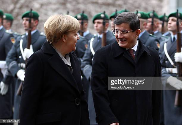 German Chancellor Angela Merkel welcomes Turkish Prime Minister Ahmet Davutoglu with the military honor ceremony upon Davutoglu's arrival for talks...