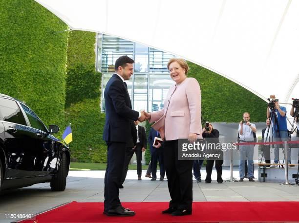 German Chancellor Angela Merkel welcomes Ukrainian President Volodymyr Zelensky upon Zelensky's arrival at the Chancellery on June 18 2019 in Berlin...