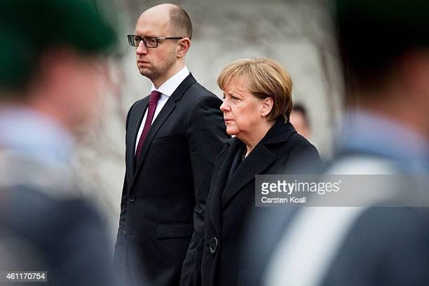 German Chancellor Angela Merkel welcomes Ukrainian Prime Minister Arseniy Yatsenyuk with the millitray honour ceremony upon Yatsenyuk's arrival for...
