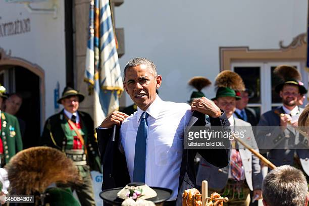 German Chancellor Angela Merkel welcomes US President Barack Obama before the G7 summit at Castle Elmau at the town hall of the village Krün along...