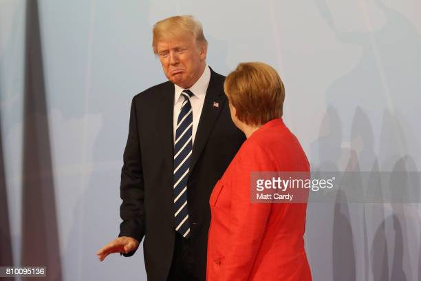 German Chancellor Angela Merkel welcomes US President Donald Trump at the start of the the G20 summit on July 7 2017 in Hamburg Germany Leaders of...