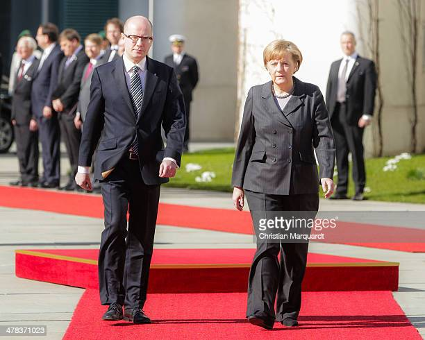 German Chancellor Angela Merkel welcoms the Czech Prime Minister Bohuslav Sobotka with military honors in the Chancellery on March 13, 2014 in...