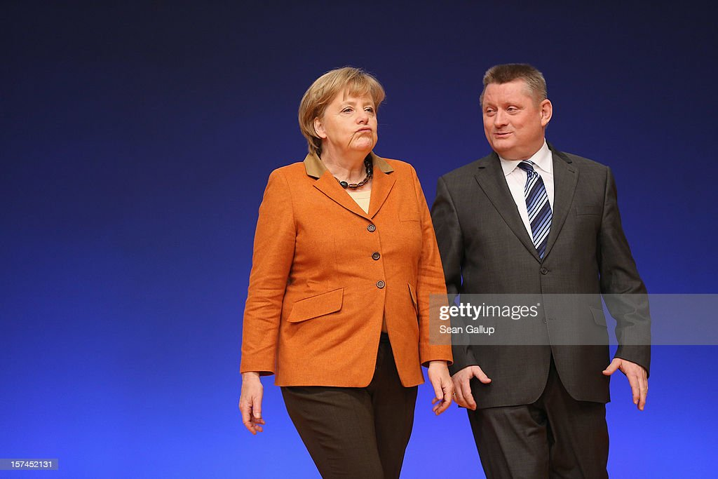 German Chancellor Angela Merkel, who is also chairwoman of the German Christian Democratic Union (CDU), does a brief walk through with CDU General Secretary Hermann Groehe in the main convention hall prior to the CDU federal party convention on December 3, 2012 in Hanover, Germany. The CDU has a strong lead over its opponents though has recently lost the mayoral posts in several major German cities to opposition parties. Germany faces federal elections in 2013.
