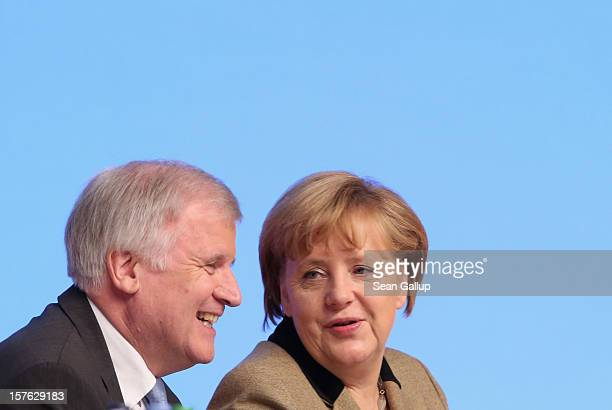 German Chancellor Angela Merkel who is also chairwoman of the German Christian Democratic Union chats with Horst Seehofer Chairman of the Christian...