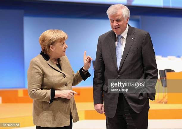 German Chancellor Angela Merkel who is also chairwoman of the German Christian Democratic Union accompanies Horst Seehofer Chairman of the Christian...