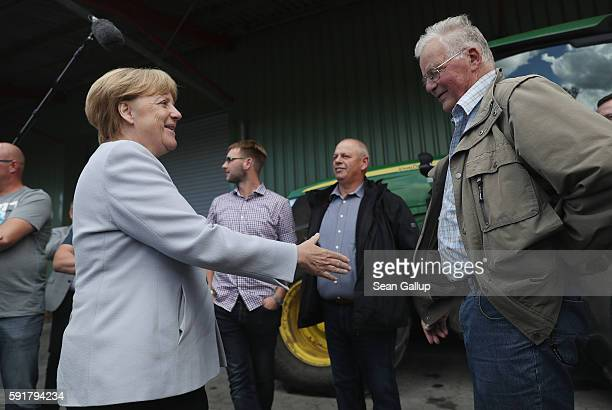German Chancellor Angela Merkel, who is also chairwoman of the German Christian Democrats , greets farmers during a Mecklenburg-Western Pomerania...