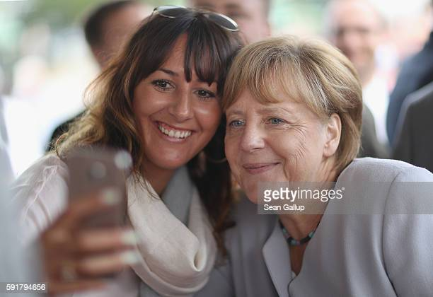 German Chancellor Angela Merkel, who is also chairwoman of the German Christian Democrats , poses for a selfie during a Mecklenburg-Western Pomerania...