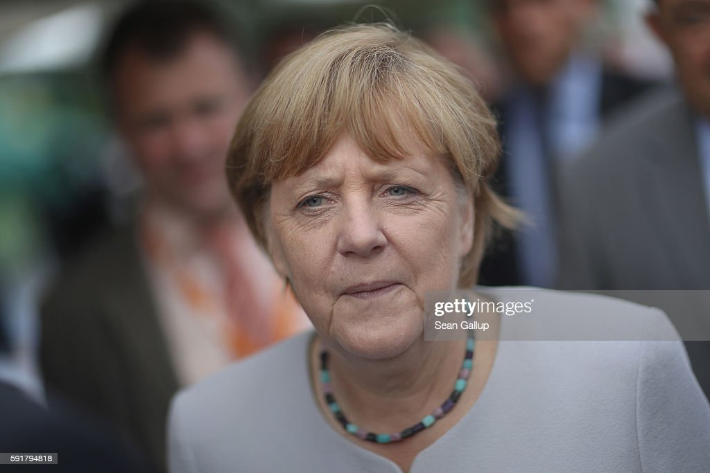 German Chancellor Angela Merkel, who is also chairwoman of the German Christian Democrats (CDU), attends a Mecklenburg-Western Pomerania election campaign event at the Zinzow farming cooperative (Agrargenossenschaft Zinzow) on August 18, 2016 in Boldekow, Germany. Mecklenburg-Western Pomerania, one of Germany's 16 federal states (Bundeslaender), is scheduled to hold elections on September 4. So far the CDU is close in the polls against the German Social Democrats (SPD). The populist Alternative fuer Deutschland (AfD), a political newcomer that is attracting right-wing voters, has double-digit support and will certainly gain seats.