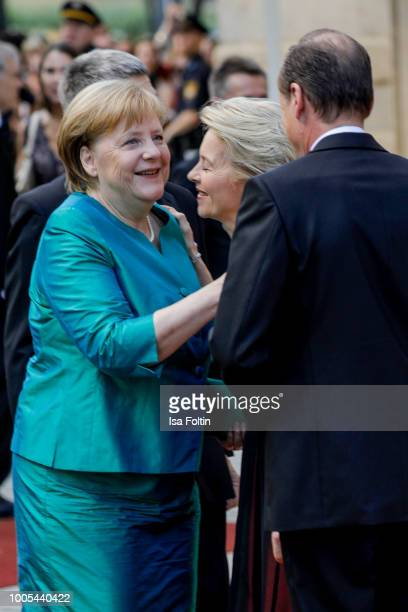 German Chancellor Angela Merkel with erman Defence Minister Ursula von der Leyen and her husband Heiko von der Leyen during the opening ceremony of...