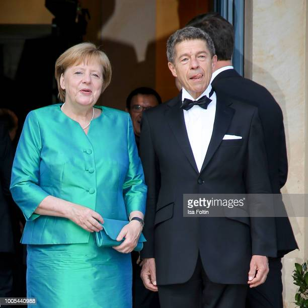 German Chancellor Angela Merkel with her husband Joachim Sauer during the opening ceremony of the Bayreuth Festival at Bayreuth Festspielhaus on July...