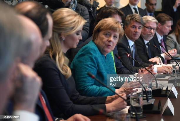 German Chancellor Angela Merkel with Ivanka Trump speaks during a roundtable discussion on vocational training with United States and German business...