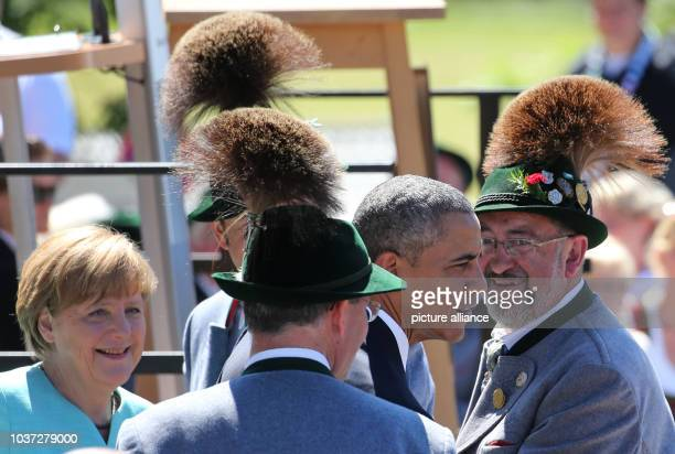 German Chancellor Angela Merkel with US President Barack Obama in Kruen, Germany, 07 June 2015 before they attend the G7 summit in...