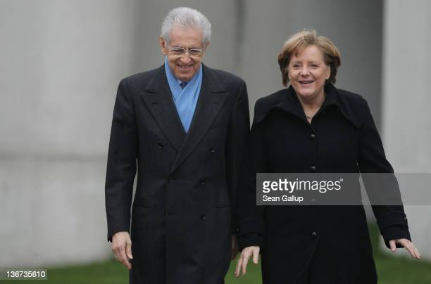 German Chancellor Angela Merkel wlcomes Italian Prime Minister Mario Monti upon Monti's arrival at the Chancellery on January 11, 2011 in Berlin,...